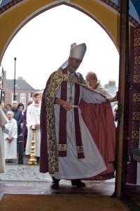 Bishop opens door