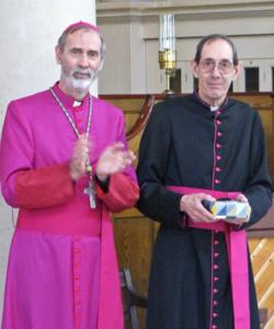 Bishop applauding Mgr Stokes