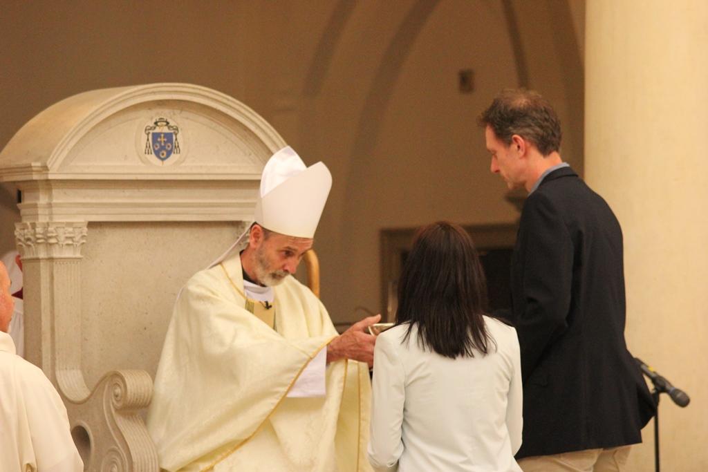 Bishop receiving gifts