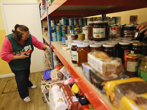 Lady selecting food items from shelf