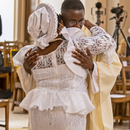 Paschal and his mother embrace