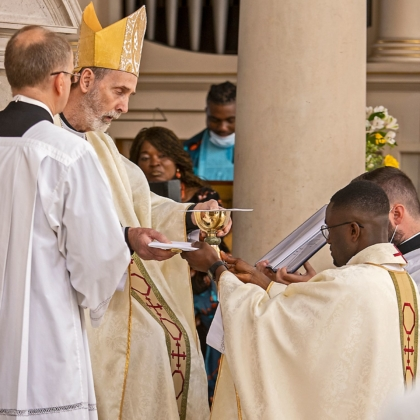 Bishop gives Paschal chalice and paten