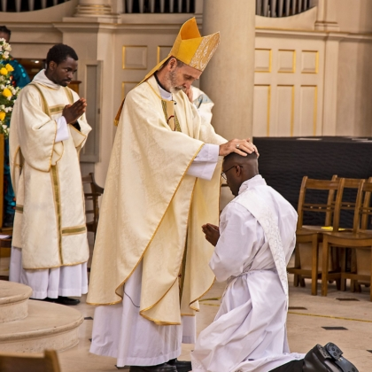 Bishop lays hands on Paschal's head