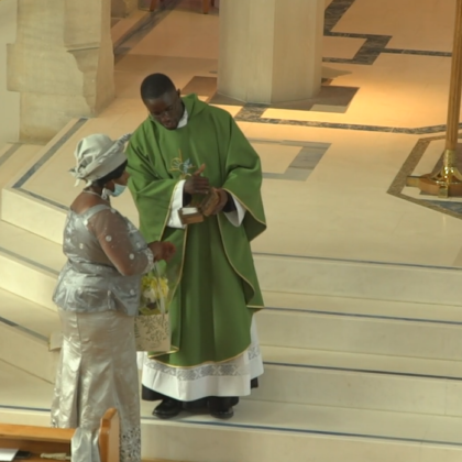 Paschal presents cloth to mother