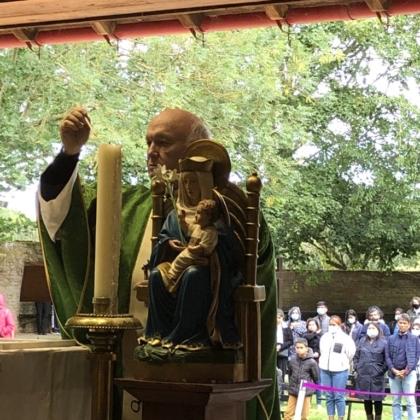 Mgr John Armitage lights candle for last time at Walshingham