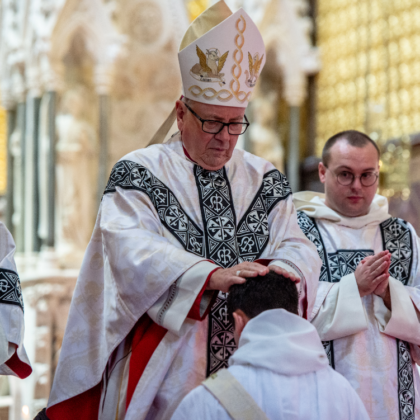 Bishop lays hands on Joseph'shead