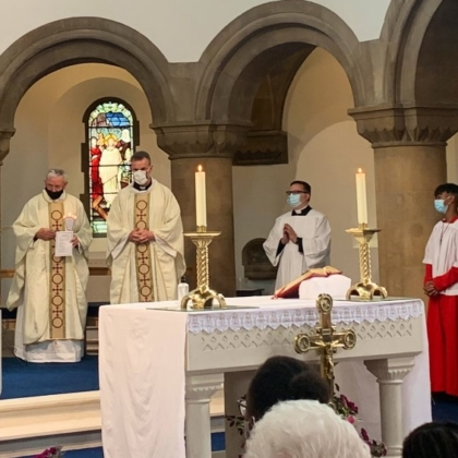 Bishop and clergy in vestments