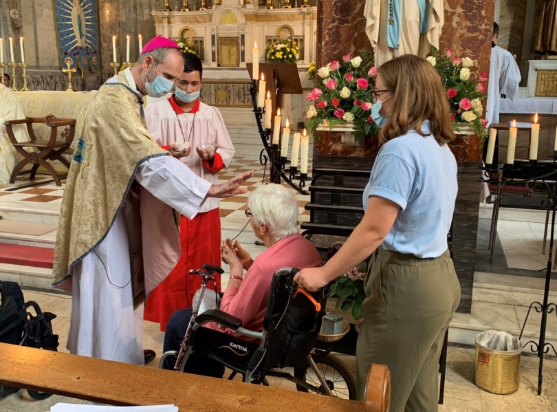 Bishop reaches out to pilgrim in wheelchair