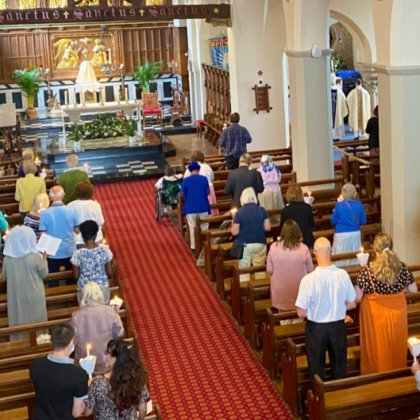 View of aisle with people in pews